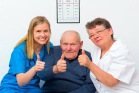 elderly with two caregivers