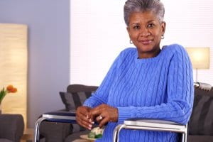 woman sitting in wheelchair and smiling